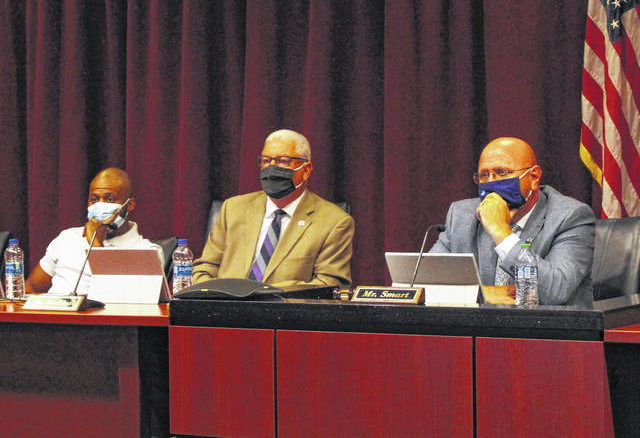 Gavin Stone | Daily Journal                                 From left, Commissioners Tavares Bostic and Rick Watkins, and Chairman Jeff Smart wear masks in the Board of Commissioners' regular monthly meeting room in the Richmond County Judicial Center for the first time since they returned to in-person meetings.
