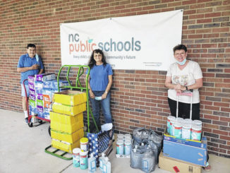 Photo courtesy of Elsie Freeman                                 Members of the Mission Team from First Baptist Church Of Ellerbe (Linda Stooksbury, Lee & Elsie Freeman) donated and delivered school supplies to Mineral Springs Elementary School (paper, pencils, erasers, glue sticks, Kleenex Tissues and hand sanitizers).