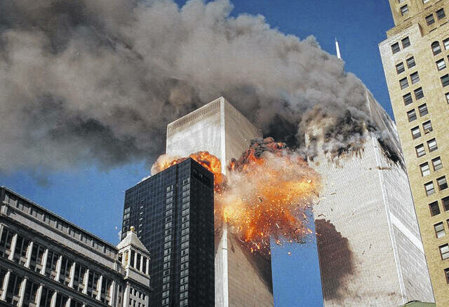 AP Photo | Chao Soi Cheong                                 Smoke billows from one of the towers of the World Trade Center as flames and debris explode from the second tower, Tuesday, Sept. 11, 2001.