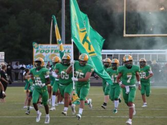 The Raiders take to the field ahead of a regular season game against Cardinal Gibbons on Sept. 3.                                  Neel Madhavan | Daily Journal File Photo