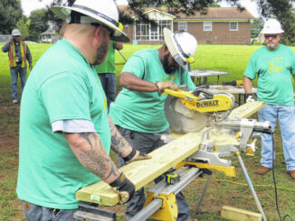 Clint Long and J.R. McLaughlin, volunteers from Piedmont Natural Gas, pitched in their time to help build a deck at a home on Country Canyon Drive.