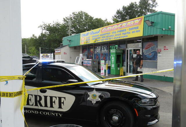 Sheriff's deputies respond to the Mill Road Grocery following a gun shot being fired in the story at mid-day on Monday.                                  Matthew Sasser | Daily Journal
