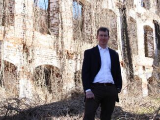 John Hutchinson at the Great Falls Mill ruins, the inspiration for his financial planning business's name, Great Falls Wealth Management.