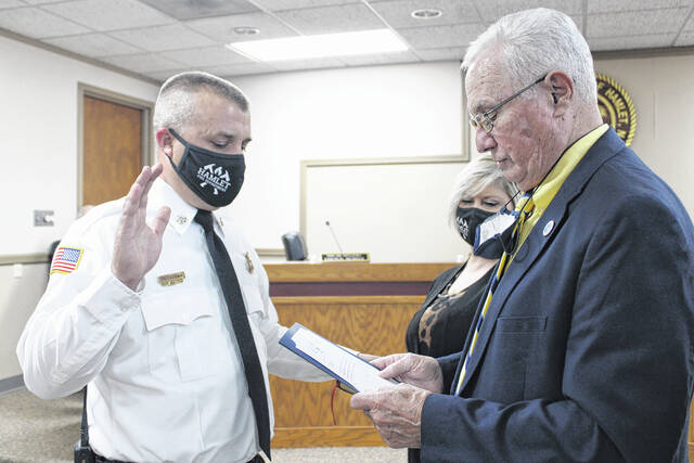 Gavin Stone | Daily Journal                                 Mayor Bill Bayless swears in Trey Goodwin as Hamlet's new fire chief.