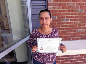 Photo courtesy of RCC                                 Rosaura De Watson holds the certificate that grants her U.S. Citizenship. She took a class at Richmond Community College that prepared her for the interview process as well as an English as a Second Language class.